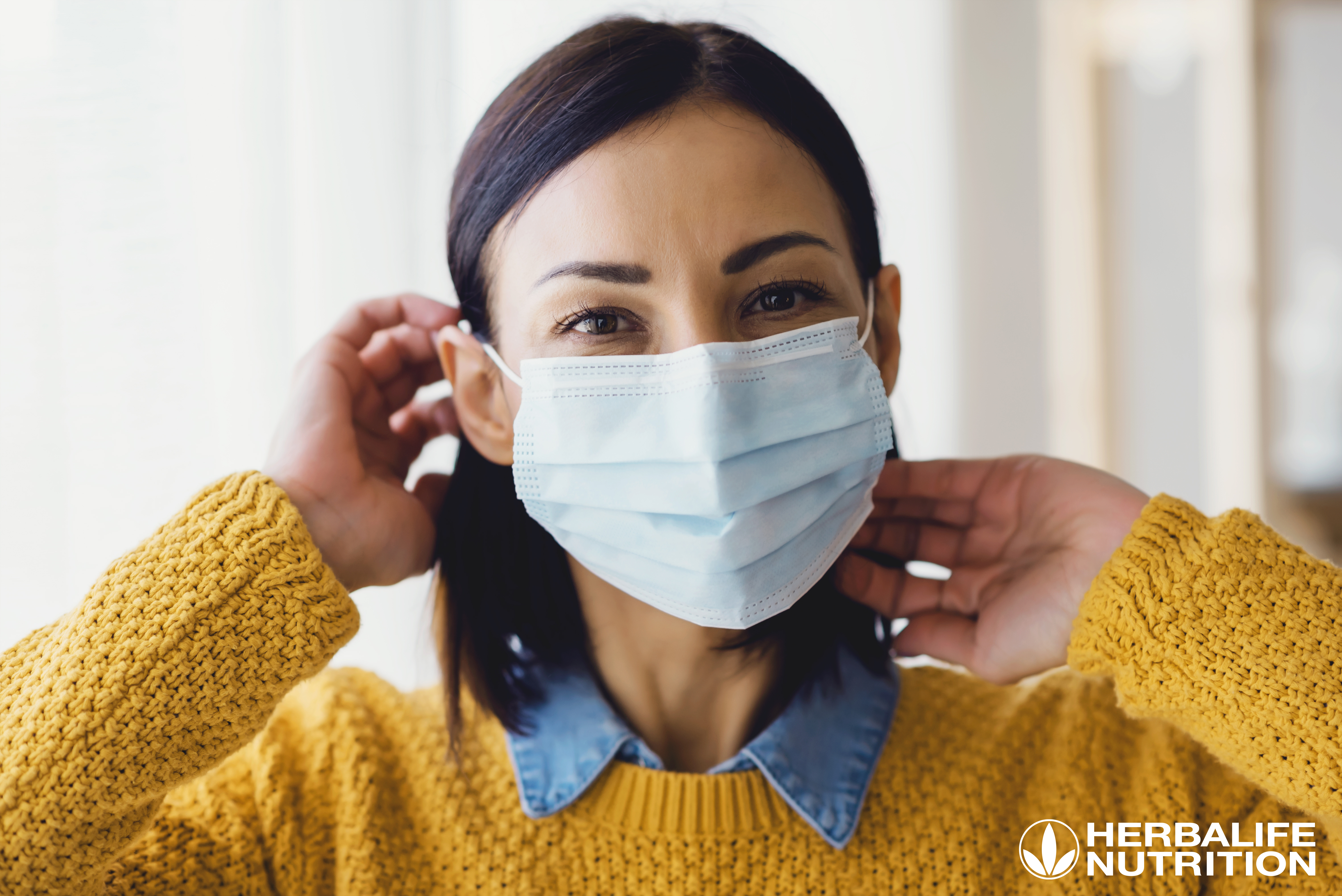 Portrait of young Asian woman,  wearing a medical surgical dispo